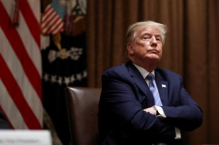 U.S. President Donald Trump listens during a roundtable discussion on