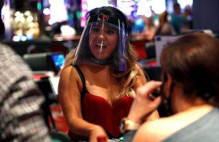 A blackjack dealer wears a face shield during the reopening of The D hotel-casino, closed by the state since March 18, 2020 as part of steps to slow the spread of the coronavirus disease (COVID-19), in downtown Las Vegas, Nevada, U.S. June 4, 2020. REUTER