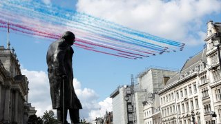 The Red Arrows and La Patrouille de France perform a flypast over a statue ofWinstonChurchill, during a meeting of British Prime Minister Boris Johnson and French President Emmanuel Macron in London, Britain, June 18, 2020. REUTERS/Peter Nicholls