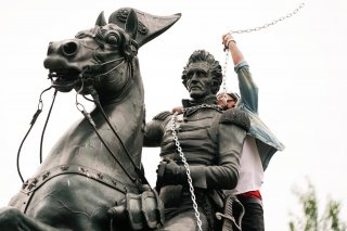 A protestor wraps chains around the neck of the statue of U.S. President Andrew Jackson during an attempt by protestors to pull the statue down in the middle of Lafayette Park in front of the White House during racial inequality protests in Washington, D.