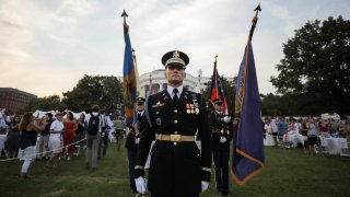 A U.S. military color guard stands on the White House South Lawn after U.S. President Donald Trump hosted a 4th of July