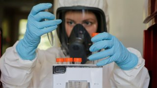 A scientist works inside a laboratory of the Gamaleya Research Institute of Epidemiology and Microbiology during the production and laboratory testing of a vaccine against the coronavirus disease (COVID-19), in Moscow, Russia August 6, 2020. Picture taken