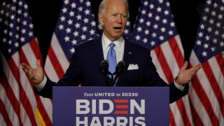 Democratic presidential candidate and former Vice President Joe Biden gestures as he speaks at a campaign event, on his first joint appearance with Vice presidential candidate Senator Kamala Harris after being named his running mate, at Alexis Dupont High