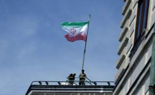 The national flag of Iran is seen on top of the Austrian Chancellery during the visit of President Hassan Rouhani in Vienna, Austria July 4, 2018. REUTERS/Lisi Niesner