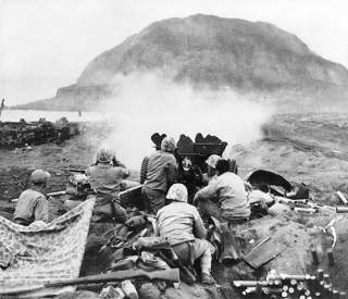 https://en.wikipedia.org/wiki/Battle_of_Iwo_Jima#/media/File:37mm_Gun_fires_against_cave_positions_at_Iwo_Jima.jpg