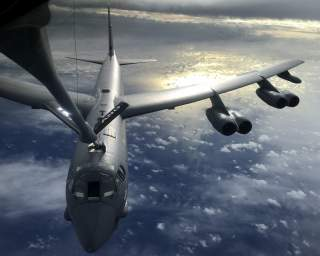 A U.S. Air Force KC-135 Stratotanker, assigned to the 506th Expeditionary Air Refueling Squadron, refuels a B-52 Stratofortress over the Indian Ocean June 10, 2018. (U.S. Air Force photo by Airman 1st Class Gerald R. Willis). Flickr / U.S. Department of D