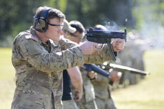 A student assigned to the U. S. Army John F. Kennedy Special Warfare Center and School who is in the Special Forces Weapons Sergeant Course fires an MP5K submachine gun during weapons training at Fort Bragg, North Carolina May 12, 2020.