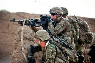 A machine gun crew with the 82nd Airborne Division's 2nd Battalion, 504th Parachute Infantry Regiment, sets up an overwatch position during a foot patrol May 8, 2012, Ghazni Province, Afghanistan. U.S. Army photo by Sgt. Michael J. MacLeod