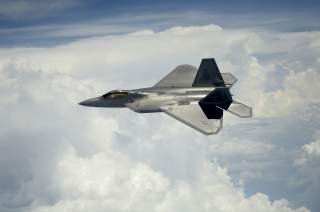 A U.S. Air Force F-22 Raptor aircraft assigned to the 1st Fighter Wing pulls away to fly beside a KC-135 Stratotanker aircraft assigned to the 756th Air Refueling Squadron while a second F-22 refuels over Joint Base Andrews in Maryland July 10, 2012. Flic