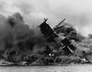 By Photographer: UnknownRetouched by: Mmxx - This is a retouched picture, which means that it has been digitally altered from its original version. The original can be viewed here: The USS Arizona (BB-39) burning after the Japanese attack on Pearl Harbor