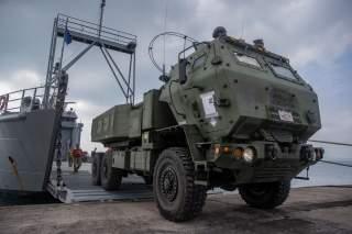 https://www.dvidshub.net/image/5874319/us-marine-high-mobility-artillery-rocket-system-embarks-army-landing-craft