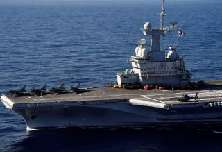 A picture taken off Toulon shows the aircraft carrier