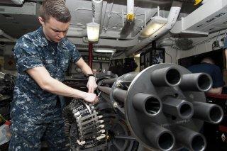 Aviation Ordnanceman Airman James Sather performs maintenance on an M61A2 20 mm Gatling gun in the bomb shop aboard aircraft carrier USS Harry S. Truman (CVN 75). 28 January 2013. U.S. Navy.