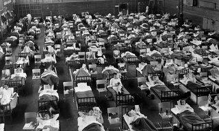 168 sick conscripts by asian flu in a sport arena att F 21 in Luleå. Picture was taken in 1957. Public Domain.