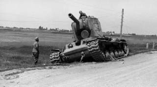 An abandoned Soviet KV-2 tank left by the roadside inspected by curious German soldiers. One KV-2, in some accounts, held up the entire 6th Panzer Division for a single day before being finally overwhelmed.