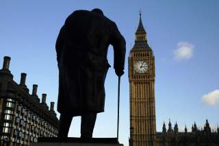 The statue of Britain's former Prime Minister Winston Churchill is silhouetted in front of the Houses of Parliament in London.