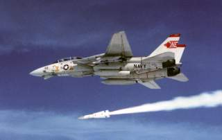 A U.S. Navy Grumman F-14A Tomcat from fighter squadron VF-1 Wolfpack launching an AIM-54 Phoenix missile. VF-1 was assigned to Carrier Air Wing 2 (CVW-2) aboard the aircraft carrier USS Ranger (CV-61).