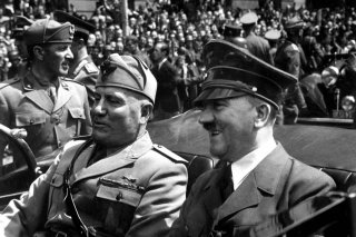 Adolf Hitler and Benito Mussolini in Munich, Germany, ca. June 1940, from Eva Braun's photo albums, seized by the U.S. government. U.S. National Archives.