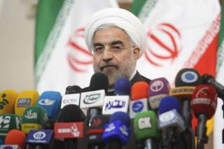 Iranian President Hassan Rouhani speaks with the media during a news conference in Tehran.