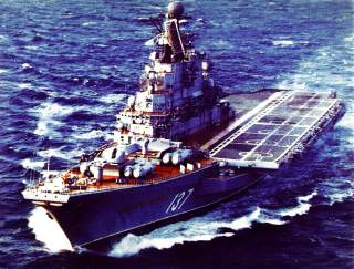 An elevated port bow view of a Soviet Kiev class aircraft carrier (CVHG) «Novorossiysk» underway. 25 March 1986