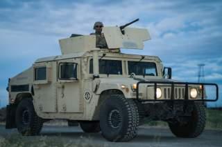 https://www.dvidshub.net/image/5536636/soldier-controls-50-cal-machine-during-perimeter-defense-exercise