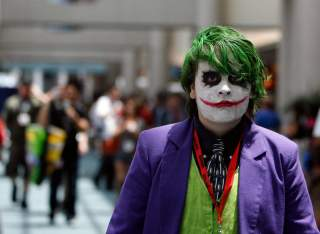 A visitor dressed like the Joker character from the movie