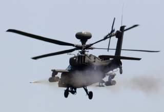 A U.S. AH-64 Apache helicopter fires a missile during a live fire gunnery exercise with the South Korean army at the U.S. army's Rodriguez range in Pocheon