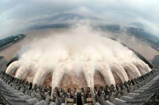 Water is discharged from the Three Gorges Dam to lower the level in its reservoir in Yichang, Hubei province July 20, 2010. Torrential rain that has lashed China for weeks has killed dozens more people in China's west and forced authorities to close shipp