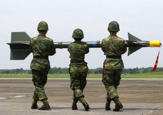 DATE IMPORTED:August 24, 2010Soldiers carry a surface-to-air missile named