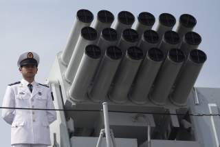 A Chinese People's Liberation Army (PLA) Navy personnel stands on the deck of the Chinese naval guided missile destroyer Haikou (171) during a welcome ceremony as it docks at the Ngong Shuen Chau Naval Base in Hong Kong April 30, 2012.