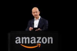 Amazon CEO Jeff Bezos demonstrates the Kindle Paperwhite during Amazon's Kindle Fire event in Santa Monica, California September 6, 2012.