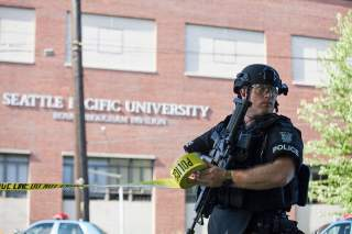 A policeman secures the scene at Seattle Pacific University after the campus was evacuated due to a shooting in Seattle, Washington June 5, 2014. A gunman opened fire on Thursday on the campus of a small Christian college in Seattle, killing one person an