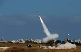 An Iron Dome launcher fires an interceptor rocket in the southern Israeli city of Ashdod July 9, 2014. At least two rockets fired from the Gaza Strip at Tel Aviv on Wednesday were shot down mid-air by Israel's Iron Dome defense system, the Israeli militar