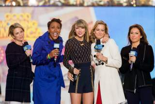 Singer Taylor Swift (C) poses with ABC's