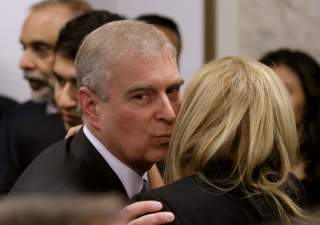 Britain's Prince Andrew greets a business leader during a reception at the sideline of the World Economic Forum in Davos January 22, 2015. REUTERS/Michel Euler/Pool