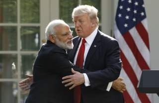 India's Prime Minister Narendra Modi hugs U.S. President Donald Trump as they give joint statements in the Rose Garden of the White House in Washington, U.S., June 26, 2017. REUTERS/Kevin Lamarque