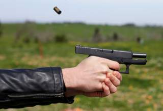 A man shots with a Glock G36 45 caliber during a practice session at a shooting range in Rome, Italy, March 22, 2018. Picture taken March 22, 2018. REUTERS/Max Rossi