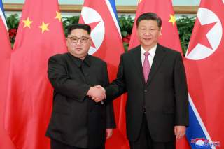 North Korean leader Kim Jong Un shakes hands with China's President Xi Jinping, in Dalian, China in this undated photo released on May 9, 2018 by North Korea's Korean Central News Agency (KCNA). KCNA/via REUTERS ATTENTION EDITORS - THIS PICTURE WAS PROVID
