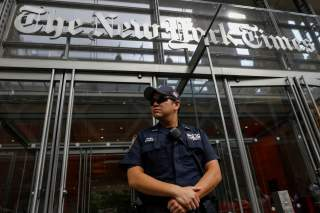 A New York Police officer is seen deployed outside the New York Times building following a fatal shooting at a Maryland newspaper, in New York City, U.S., June 28, 2018. REUTERS/Brendan McDermid