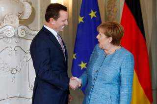 German Chancellor Angela Merkel receives the ambassador of U.S. to Germany, Richard Grenell, in Meseberg, Germany July 6, 2018. REUTERS/Axel Schmidt