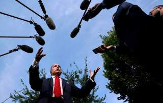Top White House economic adviser Larry Kudlow speaks to reporters at the White House in Washington, U.S., August 16, 2018. REUTERS/Kevin Lamarque