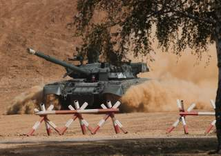A Russian T-80 U tank drives during the annual international military-technical forum