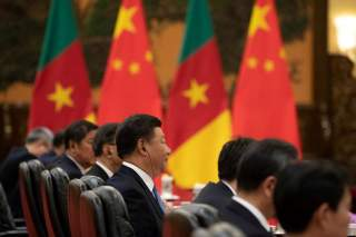 China's President Xi Jinping (C) during his bilateral meeting with President of Cameroon Paul Biya (not pictured) at the Great Hall of the People in Beijing, China, August 31, 2018. Roman Pilipey/Pool via REUTERS