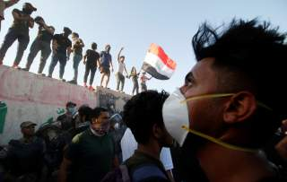 Iraqi protesters stand on concrete blast walls during a protest near the building of the government office in Basra, Iraq September 6, 2018. REUTERS/Essam al-Sudani