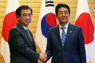 Japan's Prime Minister Shinzo Abe shakes hands with South Korea's National Intelligence Service chief Suh Hoon before their meeting at Abe's official residence in Tokyo, Japan September 10, 2018. Koji Sasahara/Pool via Reuters