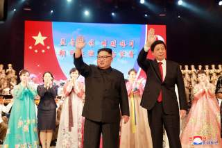 North Korean leader Kim Jong Un and China's Li Zhanshu, chairman of the Standing Committee of the National People's Congress (NPC), attend a welcoming performance in Pyongyang, North Korea, in this undated photo released September 11, 2018 by North Korea'