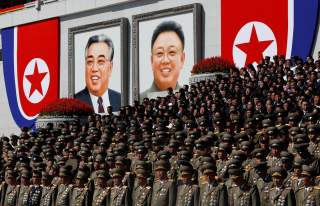 Senior military officials watch a parade as portraits of late North Korean leaders Kim Il Sung and Kim Jong Il are seen in the background at the main Kim Il Sung square in Pyongyang, North Korea, September 9, 2018. REUTERS/Danish Siddiqui SEARCH