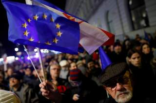 FILE PHOTO: People in front of the Presidential Palace during a protest against judicial reforms in Warsaw, Poland, November 24, 2017. REUTERS/Kacper Pempel/File Photo