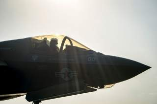 A F-35B Lightning II aircraft from the Marine Fighter Attack Squadron 211 goes through pre-flight checks before launch aboard the amphibious assault ship USS Essex as part of the F-35B's first combat strike, against a Taliban target in Afghanistan, Septem