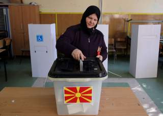 A woman casts her ballot for the referendum in Macedonia on changing the country's name that would open the way for it to join NATO and the European Union in Skopje, Macedonia September 30, 2018. REUTERS/Marko Djurica